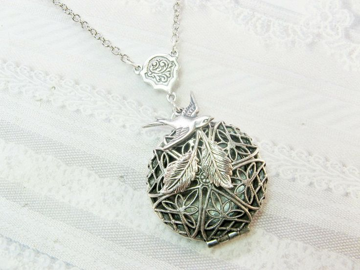 Home › birdzNbeez › BirdzNbeez Scent Lockets  Favorite  Like this item?  Add it to your favorites to revisit it later.  Silver Locket Necklace- Silver Nesting Bird Scent Locket - by BirdzNbeez -