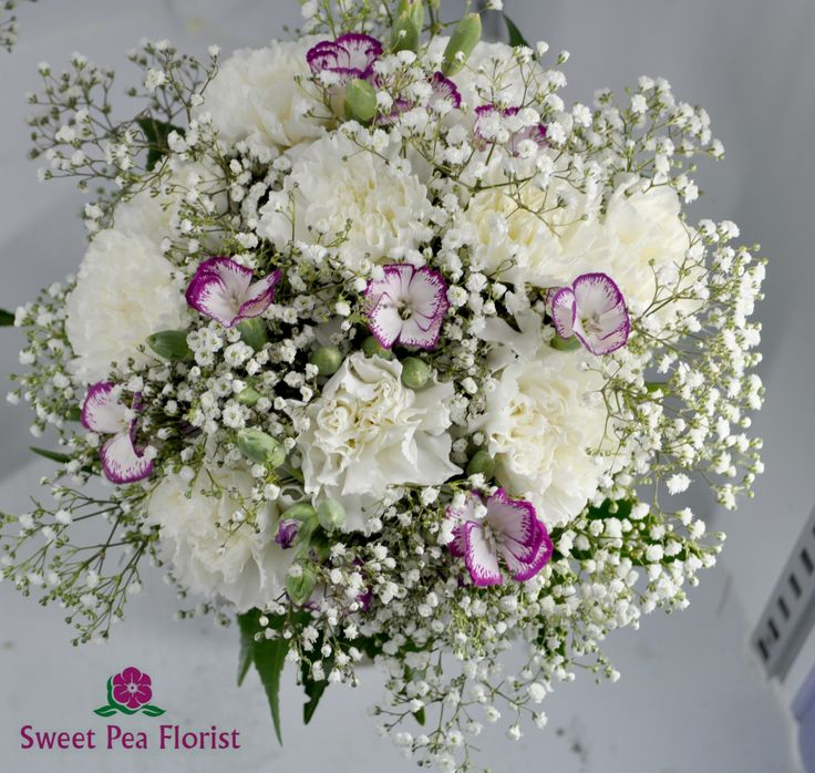 White carnations and purple spray carnations. baby breath