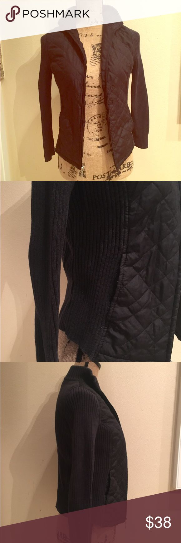Black quilted front sweater This is a total ski bunny top. It's lightly worn, warm and quilted in the front. Trendy and fun for a morning jog, or under a warm coat in the snow. Zipper side pockets and zip up front! Adorable! Sweaters