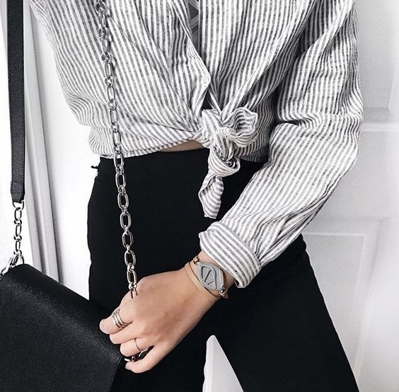 Got a casual yet fun on-the-go look, pair black jeans with a pinstriped top. Tie the top in the front for added detail. Let DailyDressMe help you find the perfect outfit for whatever the weather!