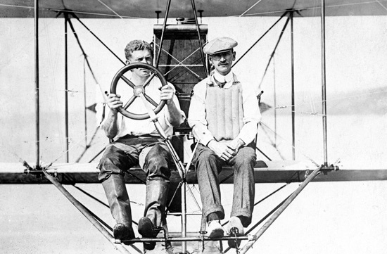 May 29, 1910: Glenn Curtiss flies from Albany NY to New York City, a then-epic flight of about 150 miles. This could loosely be credited as the first air mail flight, for he unofficially carried a letter from Albany's mayor to the mayor of NYC.