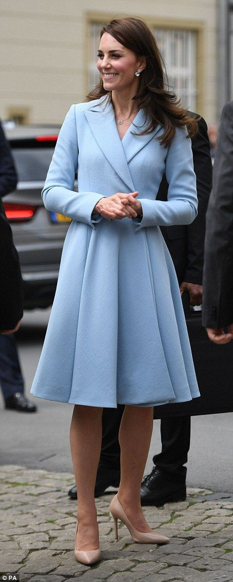 Best foot forward! The Duchess looked elegant in a full-skirted coat dress
