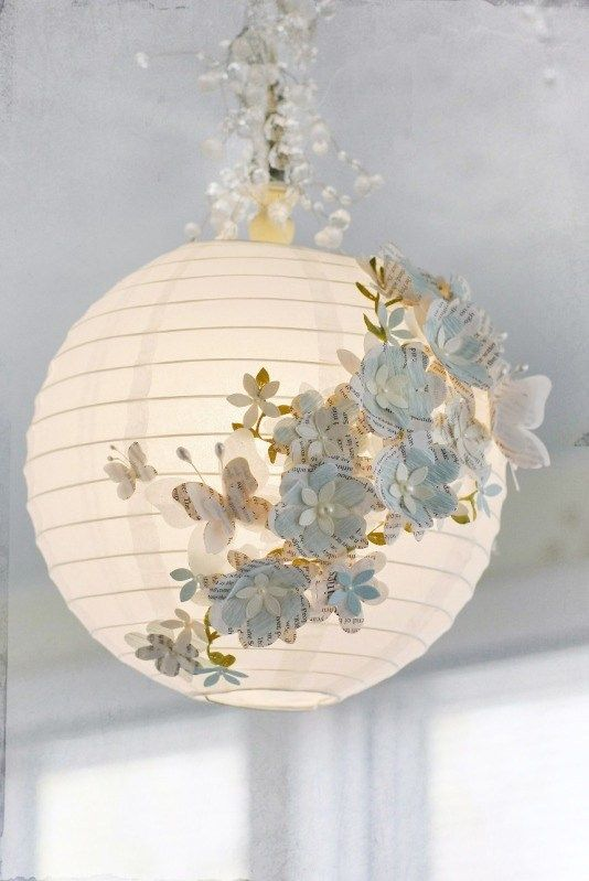 Tweet Pin It I love taking a simple object and reinventing it. This is a great example of how you can take simple objects and make something glamorous, without a ton of time or money. Linda from GlueArts uses a paper latern, pearl stamens, die cut flowers and butterflies, crepe paper and old book paper …