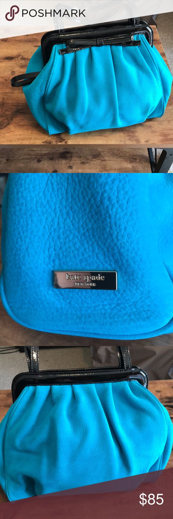 Kate spade turquoise blue suede purse Kate spade turquoise blue purse in suede. Accented with black patent bow and trim. Great condition. A few signs of wear but hardly noticeable (pictured). kate spade Bags Shoulder Bags