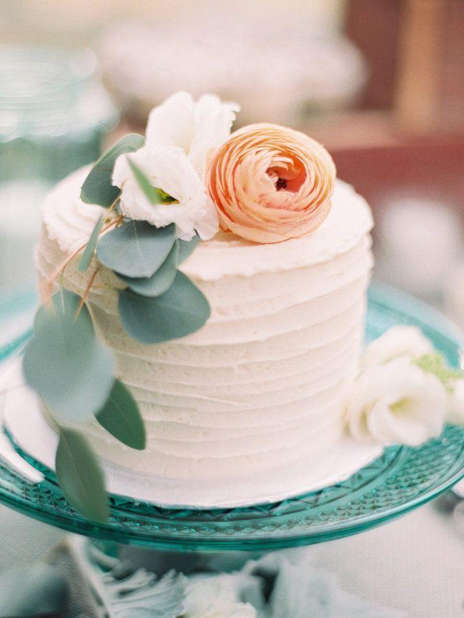 Cute floral topped mini cake: http://www.stylemepretty.com/california-weddings/san-luis-obispo/2016/01/11/rustic-chic-summer-wedding-at-flying-caballos-ranch/ | Photography: Mirelle Carmichael - http://mirellecarmichael.com/