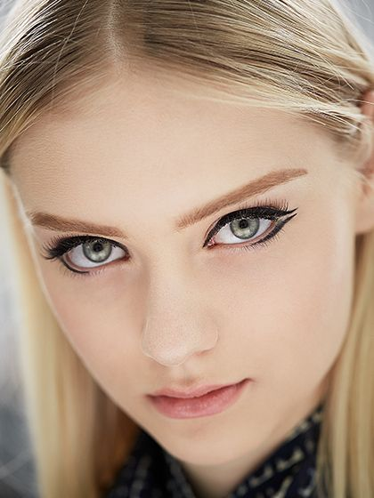Look now: Black eyeliner—Dior Addict It-Liner was used to form long black strokes at Dior fall 2014