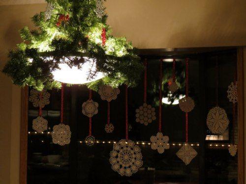 Christmas Doily snowflakes in kitchen window.