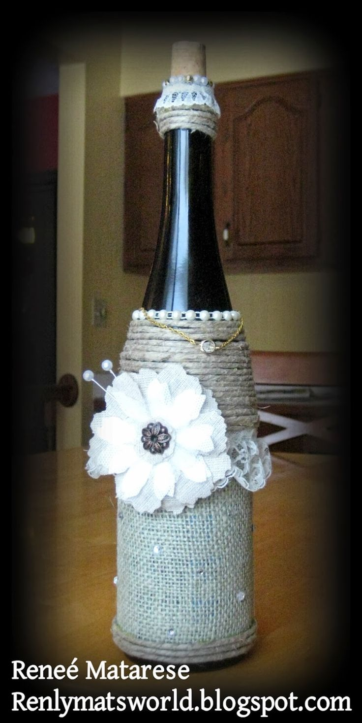 Decorated wine bottle with tim holtz tattered florals for Wine bottles decorated with flowers