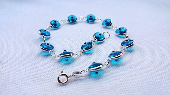 https://www.etsy.com/listing/116753754/glass-evil-eye-bracelet