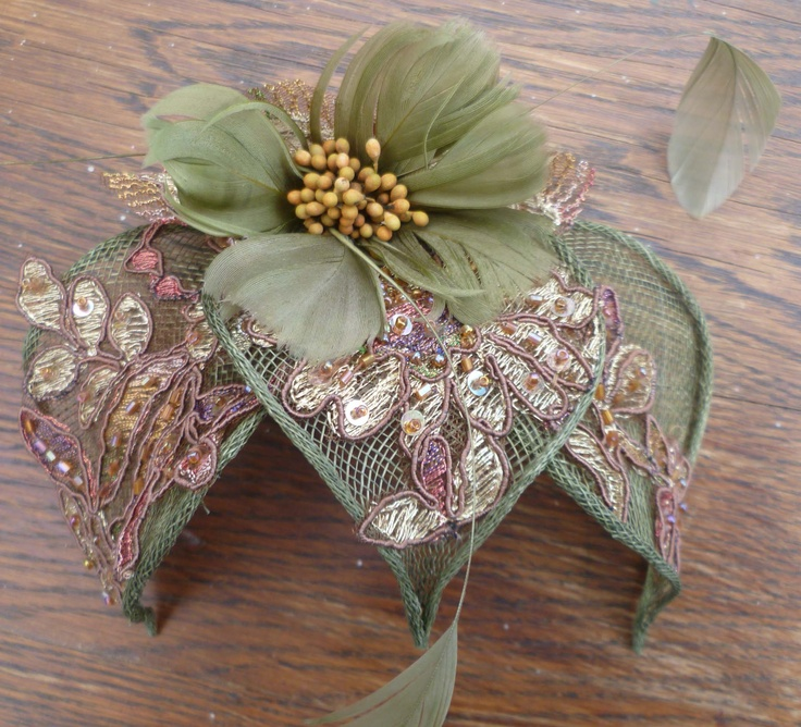 Sinamay leaves with appliques I guess attached with a comb. Hoedenhuys Suzanne