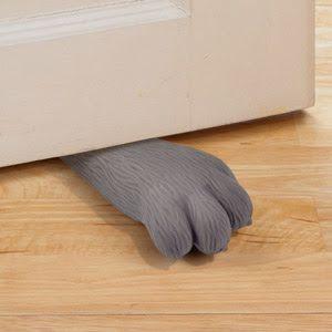 Tope para puerta en forma de pata de gato. | La Guarida Geek