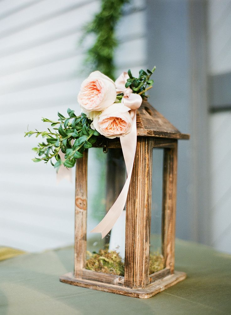 Wooden lantern topped with peach garden roses. Event Planning: Alice Hendry | Floral Design: Lauren Marie Atkinson Designs. Photography: Brooke Boling - www.brookebolingweddings.com/