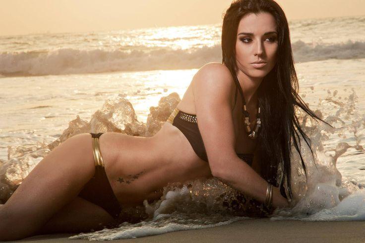 Fitness model, Roxy Barker, shows off her bikini body in this beautiful beach sunrise photo shoot.