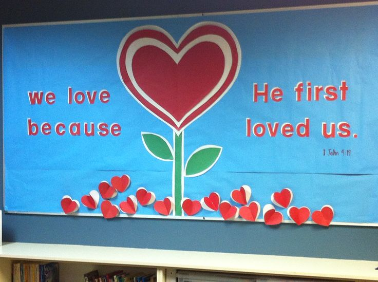 """We love because He first loved us.""   Our St. Stephen Catholic Community Resource Room February/Valentine 2014 bulletin board."