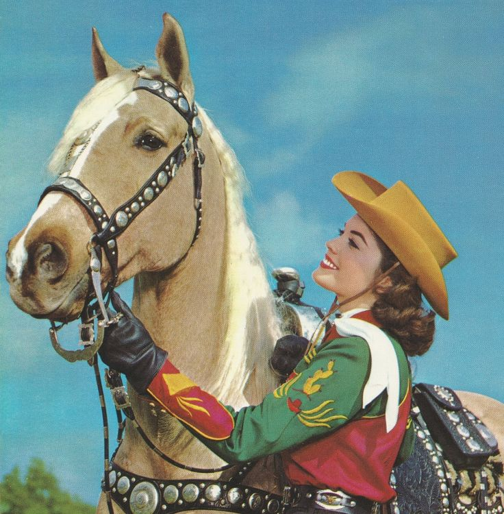 1950s cowgirl in colourful embroidered shirt, vintage western wear