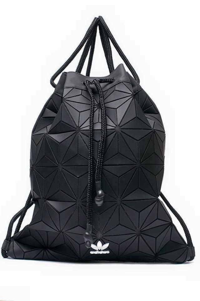 The new adidas Originals Bucket Gym Sack is as eye-catching as it is versatile. Made in faux leather, it has a shiny, 3D exterior and rope drawcords that can double as backpack straps, as well as a top carry handle so you can tote it like a handbag.