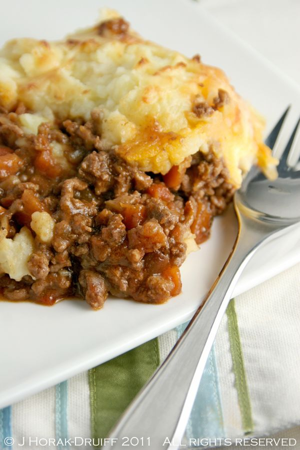 Cottage pie for comfort. Ground beef, tomatoes, spices with topping of mashed potatoes and cheese.