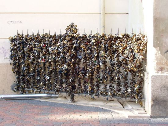 Locks of Love, Pecs, Hungary. The famous lock fence of Pécs in Hungary, where the practice is thought to have begun, in Europe at least, back in the 1980s. Area officials were quickly forced to designate this particular spot 'love lock friendly' in a bid to curb the rampant placement of lock in other areas when the trend took off.
