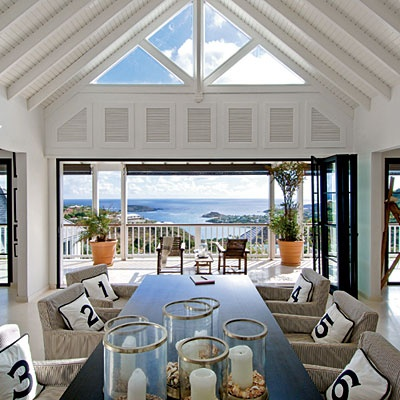 Skylight and huge doors on view of sea.