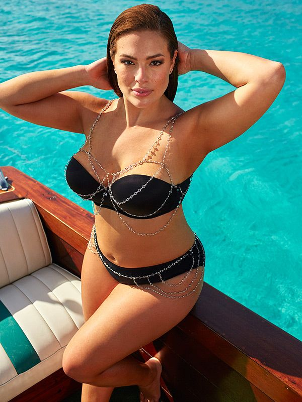 Ashley Graham in a chain-adorned black bikini - click through to see more photos from her new swimsuit line for sizes 10-24!