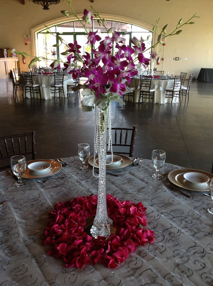 Eifflel Tower Vase With Orchids And Pearls And Full Rose Petal Base Centerpieces Pinterest