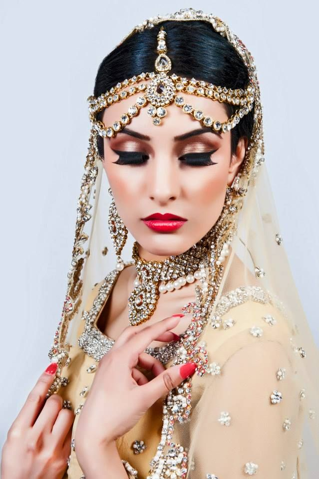 This beautiful Indian bride is dripping with gold details. Her wedding jewelry is so elegant and her nails and make up are on point!