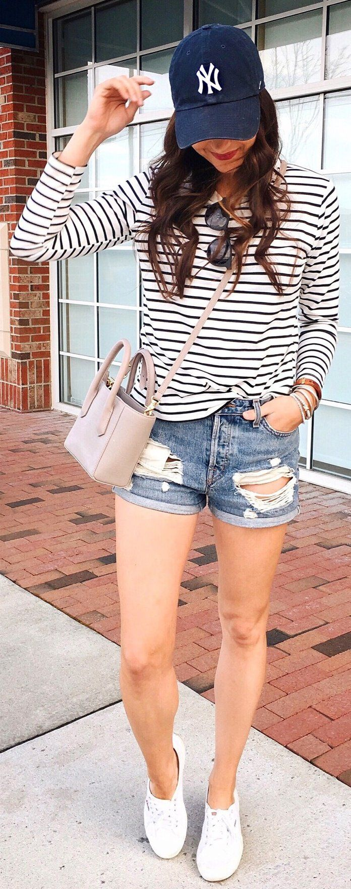 White Striped Top / Ripped Denim Short / White Sneakers / Navy Cap                                                                             Source