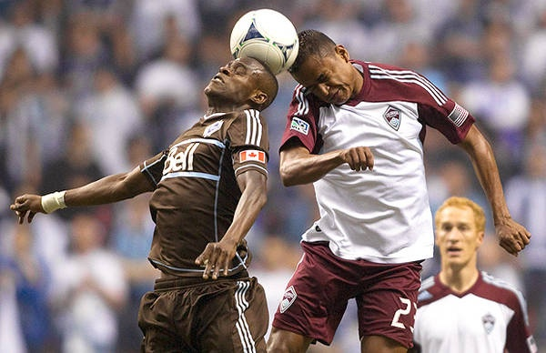 Vancouver Whitecaps 1- Colorado Rapids Vancouver Whitecaps Gershon Koffie (L) and Colorado Rapids Jaime Castrillon head the ball during the first half.    Ben Nelms/Action Images -