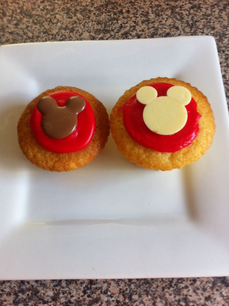 Vanilla cupcakes with chocolate Mickey decoration.