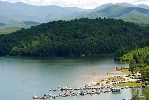 """Located on Fontana Lake in the Great Smoky Mountains of Western North Carolina, Almond Boat and RV Park invites you to """"Come relax and enjoy the Smokies! We offer pontoon rentals, boat rentals, cabin rentals, RV park rentals, boat storage, bait, fishing and hunting licenses, and the best Southern hospitality you'll find anywhere!"""