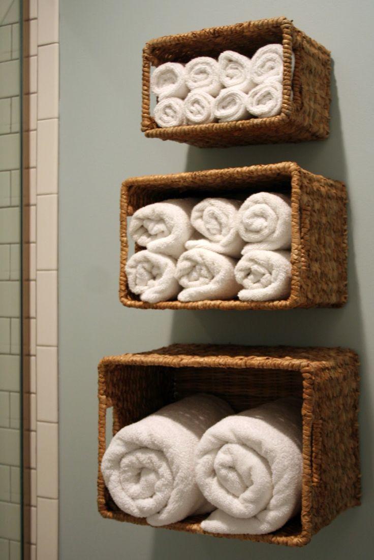 Wall baskets for bath linen storage