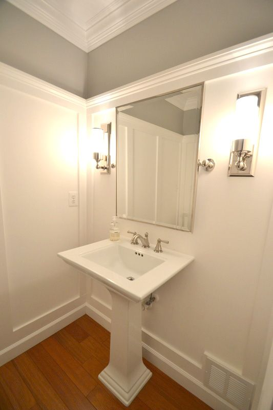 Powder Room Transformed with White Molding On Wa…