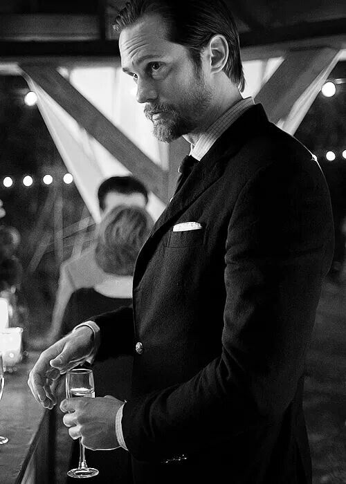 Scruffy beard and holding a glass of champagne... I think I just fell in love all over again!
