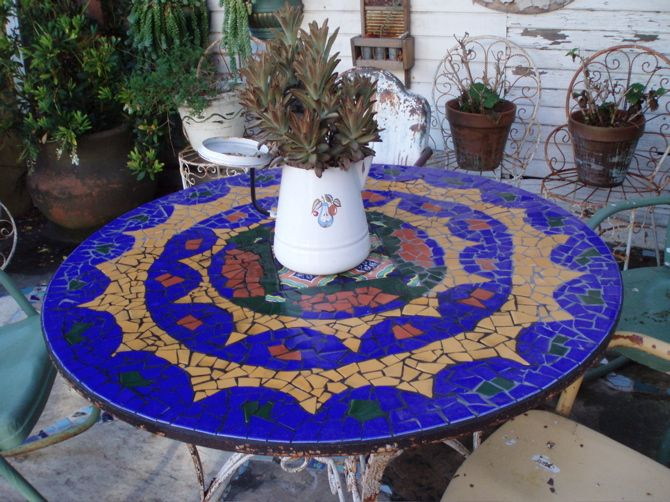 Dress up a patio table with a DIY mosaic. via Be Jane