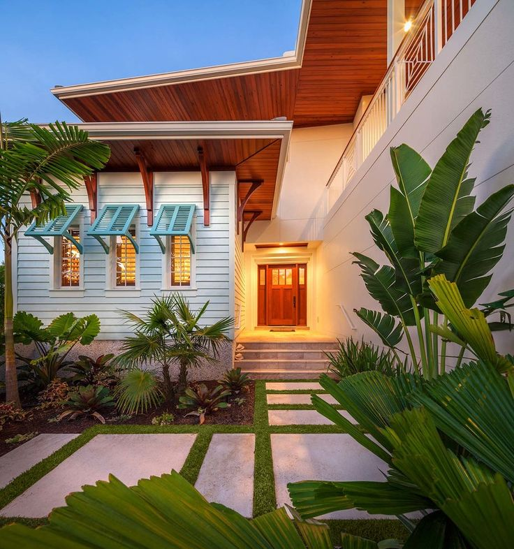 Bahama Shutters Exterior Tropical with Beige Exterior Beige Siding Blue Shutters Bushes