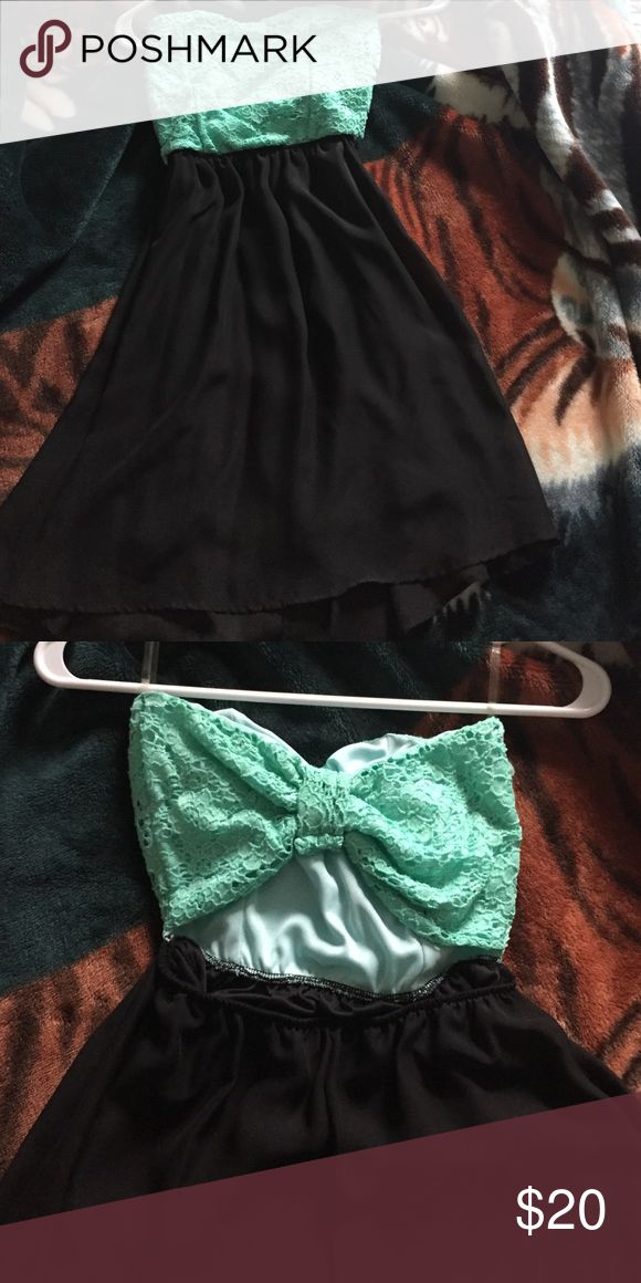 Mint Green and Black Strapless Dress Dressy Casual. worn once, strapless, has a small opening in back with cute bow tie design. I'm 5'2 and Dress is about 2 inches above my knees. Form Body Central in size small I am trying to get rid of everything in my closet, if it doesn't sell I'm just tossing it out, so don't be afraid to make offers! Body Central Dresses Strapless