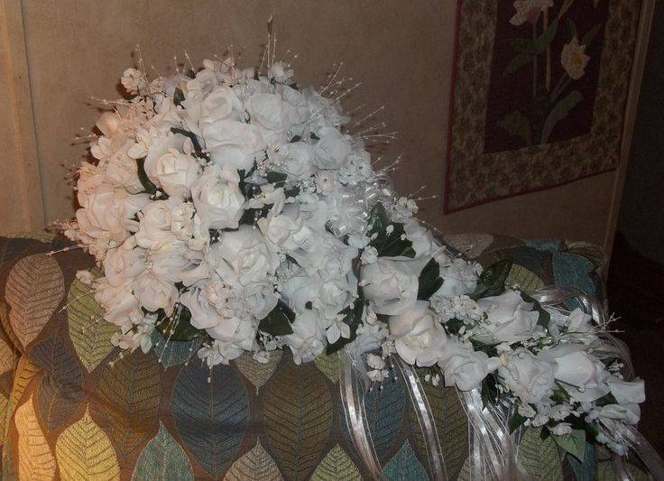 All white cascade with white pearl sprays and rhinestones