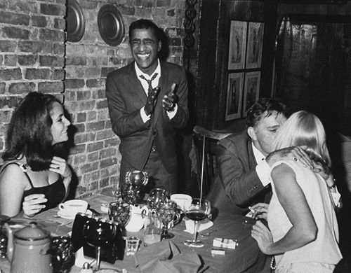 Elizabeth Taylor & Sammy Davis Jr. watch their spouses,  Richard Burton & May Britt kiss....