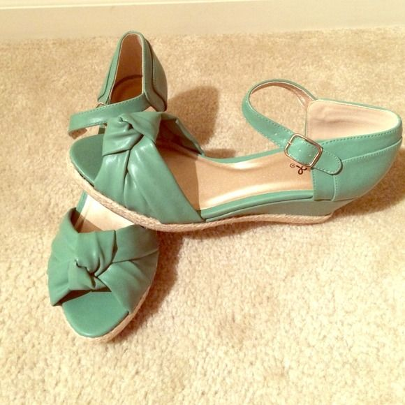 Brand new never worn mint wedges! Qupid REDUCED Never worn mint wedges with 2.5 inch heel with .5 inch platform. I bought these shoes this summer and never wore them. I bought them for $45 I will sell them for $35 Qupid Shoes