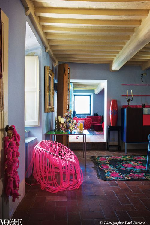 High above the Mediterranean, design consultant Stephan Hamels ancient cottage bubbles over with wildly patterned rugs and edgy designer furniture such as this fluoro pink Anemone chair design by the Campana Brothers. From Fun House, a story on page 150 of Vogue Living Nov/Dec 2010. Photograph by Paul Barbera.