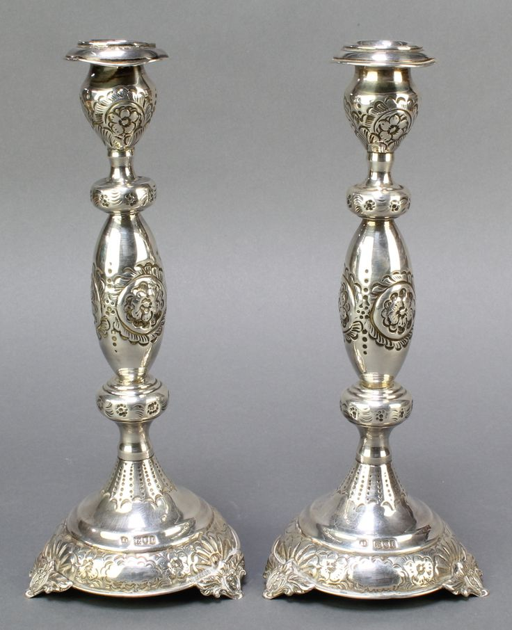 """Lot 496, A pair of Victorian silver baluster repousse candlesticks, raised on 3 panelled supports, London 1834, 10 1/2""""h,  354 grams, est £200-300"""