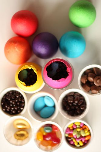 colored eggs with various candies