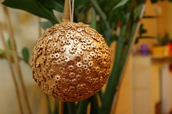 Christmas ball ornament decorated with pasta stars
