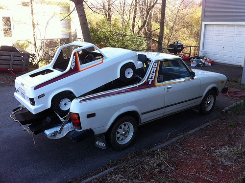 My Subaru mini Brat being hauled.