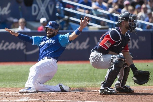 Twins rally falls short in 10-9 loss to Blue Jays  -  August 26, 2017: Toronto Blue Jays' Raffy Lopez, left, scores on a sacrifice fly in front of Minnesota Twins catcher Mitch Garver during third inning American League MLB baseball action in Toronto on Saturday, Aug. 26 2017. (Chris Young/The Canadian Press via AP)