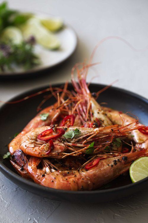 spicy glazed spot prawns served whole cooking with cocktail rings side view