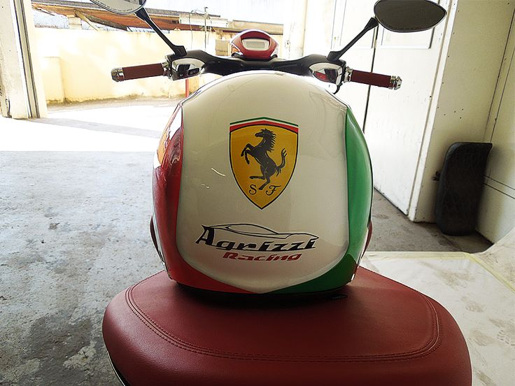 Matching Ferrari custom helmet to go with a speedy Vespa. Painted by PAZ.