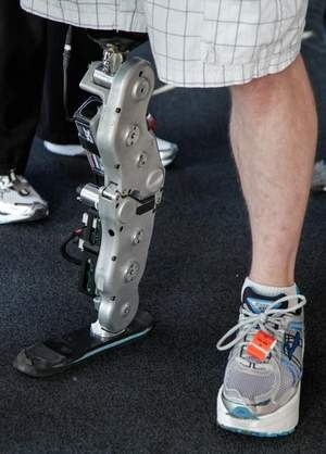 A cautious approach to the powers of wearable computers. Zac Vawter's stands on his bionic leg after he arriving on the 103rd floor of Willis Tower, becoming the first person ever to complete the task wearing the mind-controlled prosthetic limb on Nov. 4 in Chicago. Performance-boosting drugs, powered prostheses and wearable computers are coming to an office near you — but experts warn sday that too little thought has been given to the implications of a superhuman workplace. (november 2012)