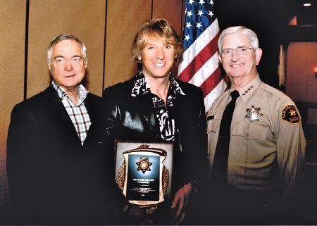 Left to Right, Mike Nesbit (President HDSA), Michael Blakey, William D. Gore (Sheriff of San Diego County). Michael is being honored by the San Diego Sheriff Department and receiving his Honorary Sheriff badge and credentials.