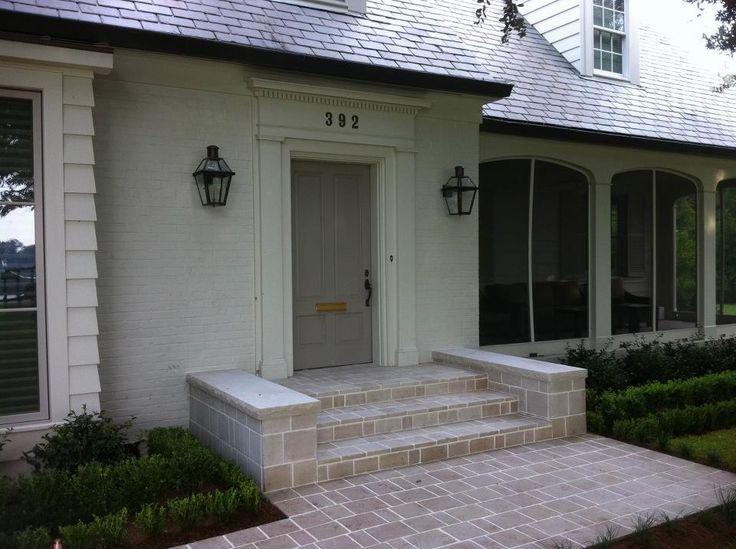 Painted brick, gray front door